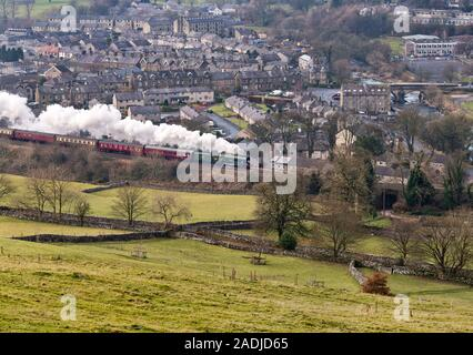 Settle, North Yorkshire, UK. 4th Dec, 2019. The Flying Scotsman steam locomotive with 'The Christmas Dalesman' steam special. Seen here at Settle travelling north to Carlisle on the famous Settle to Carlisle railway line, on a round trip from Manchester. The return trip was via Shap on the West Coast main line. Credit: John Bentley/Alamy Live News - Stock Photo