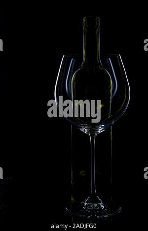 glass of red and pink wine on a black background. Wine list menu. Close up of the power of glasses and bottles in low key - Stock Photo