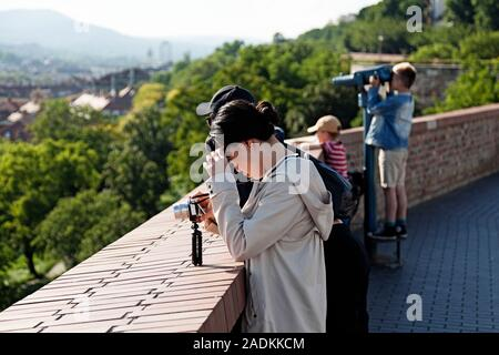 Budapest, Hungary - May 27, 2019: tourists look at the breathtaking view - Stock Photo