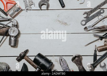 construction hammers screwdriver repair tool pliers on the board - Stock Photo