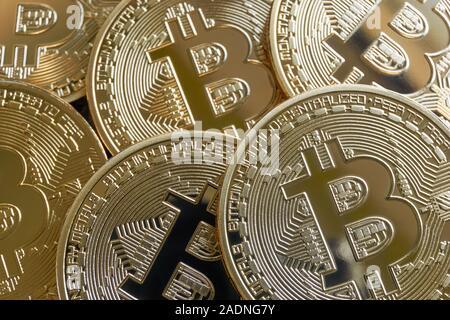 Many golden Bitcoin crypto currency blockchain coins with shiny reflections - Stock Photo