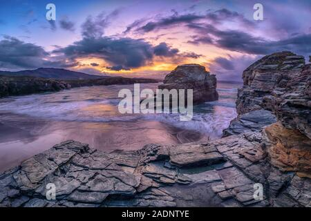 Picturesque rocks and cliffs on Praia das Illas beach which is part of Area of the Cathedrals - a protected natural area, Spain - Stock Photo