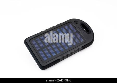 Portable and solar power battery charger for mobile phone or tablet - Stock Photo