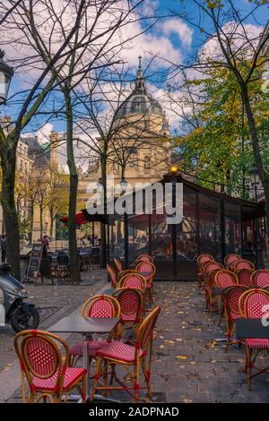 Paris, France - November 7, 2019: Typical french terrace bar in the square, in front of the chapel of the Sorbonne University. - Stock Photo