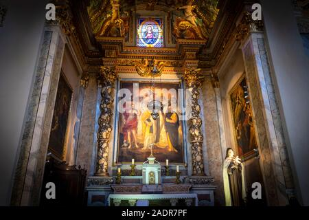 A stained glass window featuring a saint above one of the 10 interior chapels inside the baroque Sainte Reparate Cathedral, the Cathedral of Nice, Fra - Stock Photo