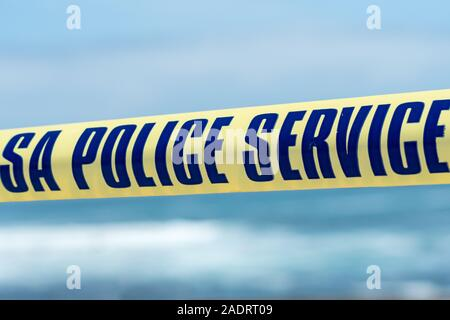 yellow tape at a crime scene in South Africa with the text or words S A police service concept public safety, security, emergency services - Stock Photo