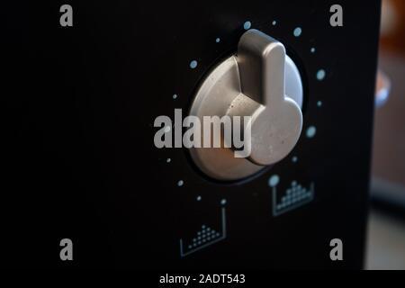 Dial knob on black background, stock photo - Stock Photo