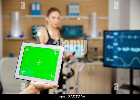 Doctor holding a digital tablet PC with chroma mock up on it - Stock Photo