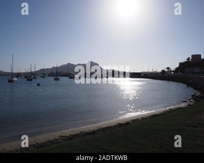 Scenery of bay with yachts and boats from grassy field in port in african Mindelo city at Sao Vicente island, Cape Verde - Stock Photo