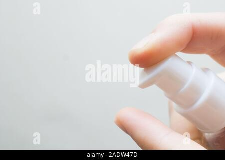 woman hands applying moisturizing cream to her finger skin from a tube. beautiful girl dropping collagen moisturizer serum into her hand at home - Stock Photo
