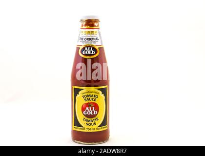 Alberton, South Africa - a glass jar of All Gold traditional tomato sauce isolated on a clear background image in horizontal format - Stock Photo
