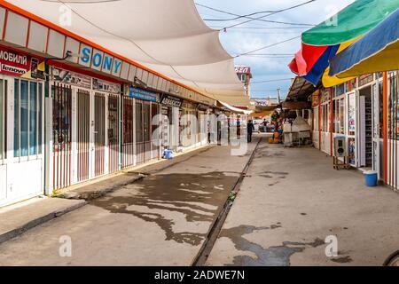 Istaravshan Tsentralnyy Rynok Gorod Bazaar View of Closed Hand Phone Stores on a Cloudy Rainy Day - Stock Photo