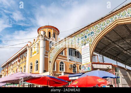 Istaravshan Tsentralnyy Rynok Gorod Bazaar Main Gate Entrance View on a Cloudy Rainy Day - Stock Photo