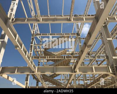 Metal frame of prefabricated multi-storey building. Metal pillars, beams, diagonal bracings and ladders
