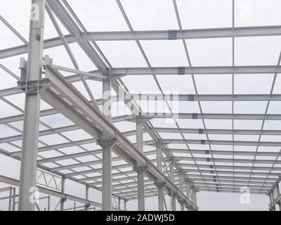 Metal frame of prefabricated multi-storey building. Metal pillars, beams and diagonal bracings
