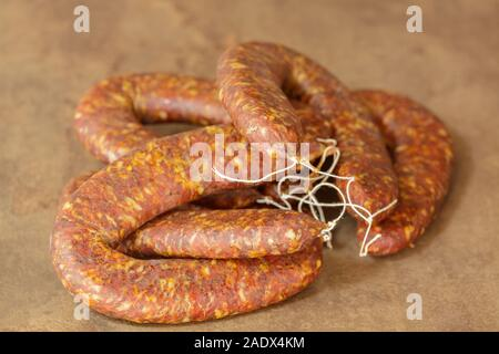 Traditional horseshoe-dried sausage.Selective focus with shallow depth of field. - Stock Photo