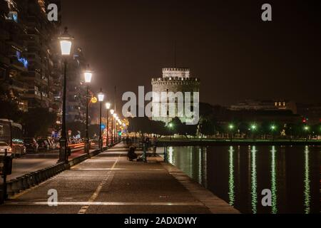 Night view of The White Tower and surrounding waterfront.The city's landmark seen from Christmas illuminated old waterfront area - Stock Photo