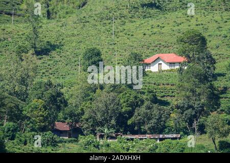A village in a mountainous area in the central province of Sri Lanka - Stock Photo