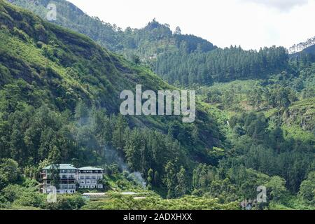 Mountain landscape in a green valley in central part of Sri Lanka - Stock Photo