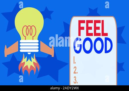 Writing note showing Feel Good. Business concept for relating to or promoting an often specious sense of satisfaction Top view launching bulb rocket f - Stock Photo