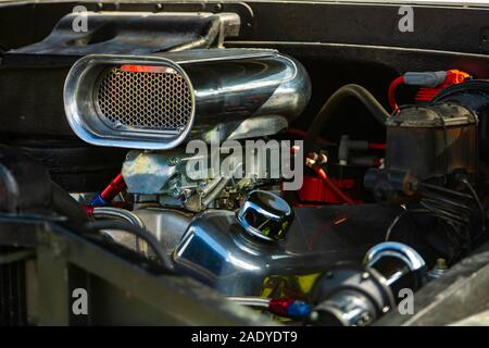 Roots type supercharger on high performance engine, chrome Air Scoop, Carburetor, Gasser Finned Air Scoop, Plain, engine parts close up - Stock Photo