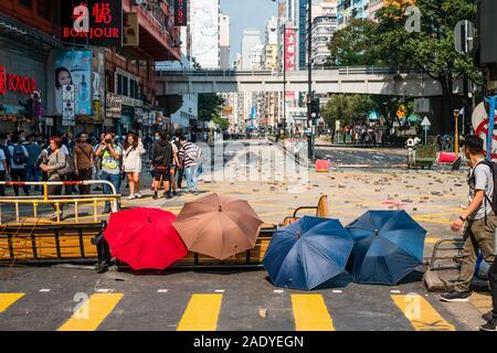 HongKong - November18, 2019: Umbreallas, the symbol of the 2019 Hongkong protests, on barricades on Nathan Road during protest in Hongkong - Stock Photo
