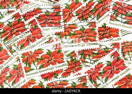 SEATTLE WASHINGTON - November 28, 2019:  Christmas stamps background of of poinsettia with blurred postage background.  Scott # 2166. - Stock Photo