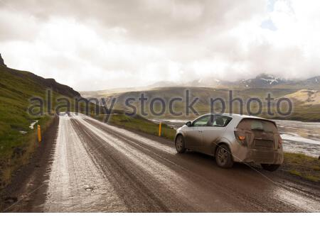 Muddy car in a road in north west Iceland (route 60) - Stock Photo