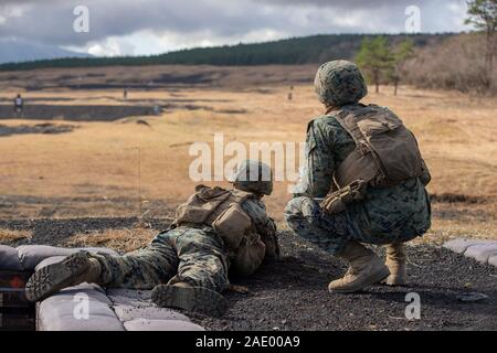 U.S. Marines conduct marksmanship drills during exercise Fuji Viper 20-2 on Camp Fuji, Japan, Dec. 3, 2019. Fuji Viper is a regularly scheduled training evolution that allows infantry units to maintain their lethality and proficiency in infantry and combined arms tactics. This iteration of the exercise is executed by an activated reserve unit, 1st Battalion, 25th Marine Regiment, currently attached to 4th Marine Regiment, 3rd Marine Division, as part of the unit deployment program. (U.S. Marine Corps photo by Lance Cpl. Ujian Gosun) - Stock Photo