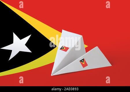 Timor Leste flag depicted on paper origami airplane. Oriental handmade arts concept - Stock Photo
