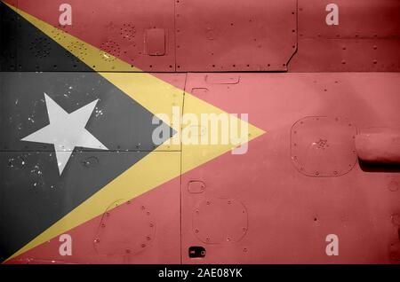 Timor Leste flag depicted on side part of military armored helicopter close up. Army forces aircraft conceptual background - Stock Photo