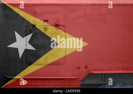 Timor Leste flag depicted on side part of military armored truck close up. Army forces vehicle conceptual background - Stock Photo