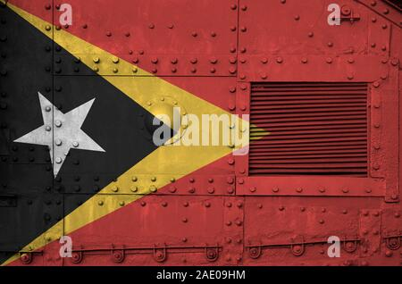 Timor Leste flag depicted on side part of military armored tank close up. Army forces conceptual background - Stock Photo