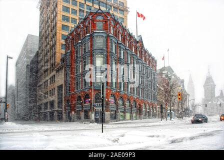 Ottawa, Canada – December 16, 2007: The historic Chambers Building, a National Historic Site, on Elgin Street during a blizzard. The Parliament Buildi - Stock Photo