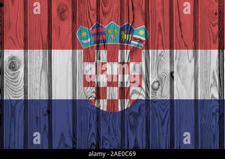 Croatia flag depicted in bright paint colors on old wooden wall close up. Textured banner on rough background - Stock Photo