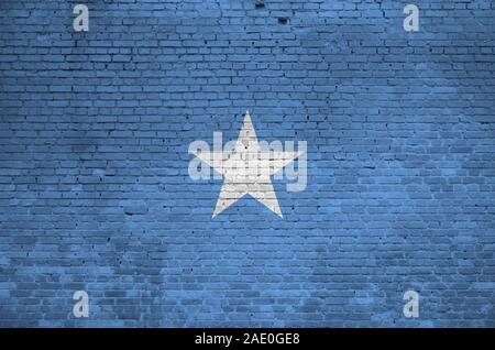 Somalia flag depicted in paint colors on old brick wall close up. Textured banner on big brick wall masonry background - Stock Photo
