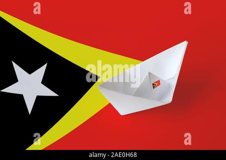 Timor Leste flag depicted on paper origami ship closeup. Oriental handmade arts concept - Stock Photo