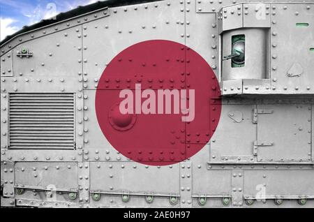 Japan flag depicted on side part of military armored tank close up. Army forces conceptual background - Stock Photo