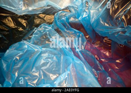 Inside a disposable plastic bag. Lightweight transparent, reusable plastic waste. Rubbish bag, plastic recycling, environmental issues