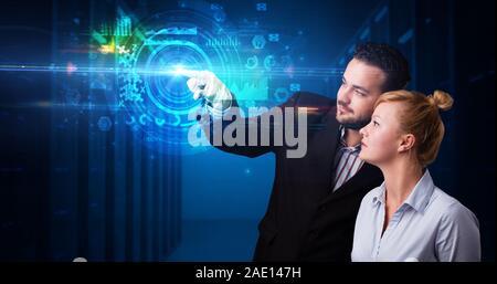 Man and woman touching hologram screen displaying medical symbols and charts