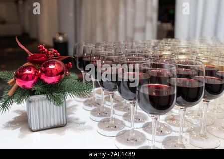 red wine in raw of crystal glasses on the Christmas buffet table - Stock Photo