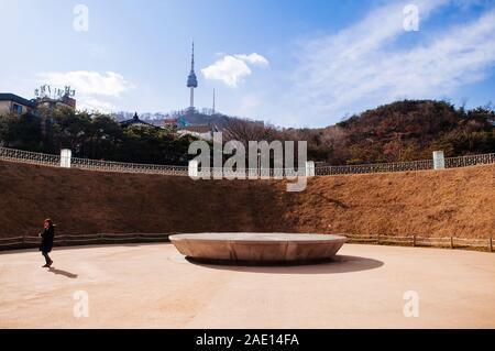 DEC 16, 2016 Seoul, South Korea - N Seoul Tower or Namsan Tower and Seoul 1000 Years Time Capsule park near Namsan Hanok historic village - Stock Photo