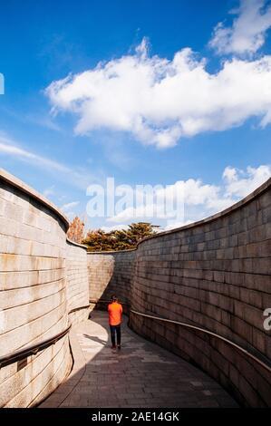 DEC 16, 2016 Seoul, South Korea - Tourist walking on passage way to Seoul 1000 Years Time Capsule park near Namsan Hanok historic village - Stock Photo