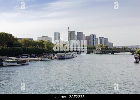 Panoramic view at Seine river with boats   seen from Pont de lene by Eiffel Tower in Paris, France - Stock Photo
