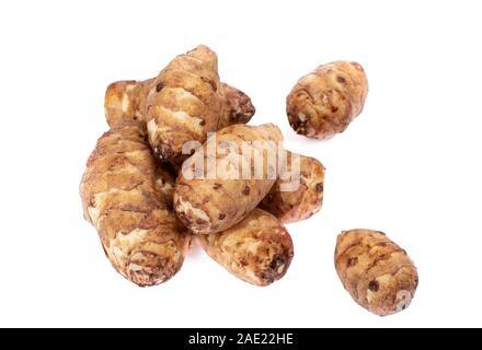 Fresh organic Jerusalem artichokes isolated on white background close up - Stock Photo