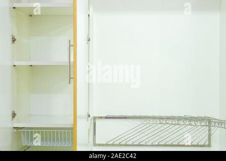Close-up interior a modern wood wardrobe, That consists of shelves, iron rail and steel hanger, Interior for modern home and decor