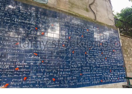 """In Paris, this is a wall of love on which the phrase """"I love you"""" is written 311 times in 250 languages - Stock Photo"""