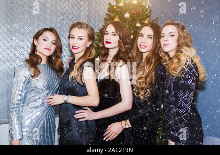 Portrait of a group of beautiful young women in the new year, Christmas. New year party, holidays, celebration, people concept - Stock Photo
