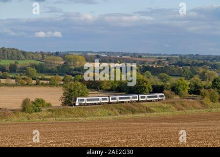 A Chiltern Railways Class 168 Clubman diesel multiple unit heading north near Clattercote Reservoir. - Stock Photo