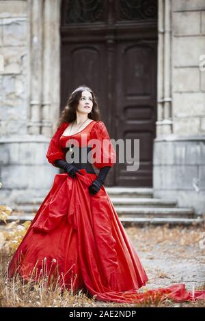 Woman in a red Victorian dress